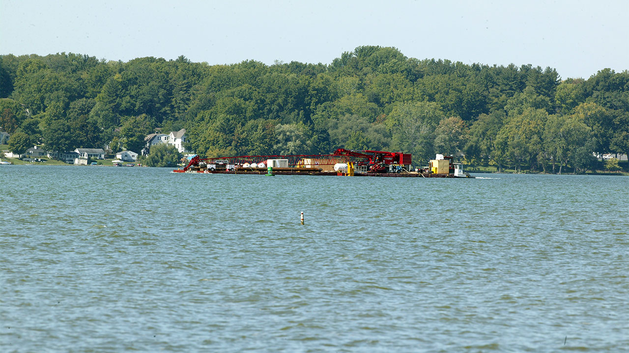 Huge barge heads down Cayuga Lake on Thursday morning